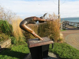 See Armando Barbon's bronze, Pure Energy, at the Sidney Seaside Sculpture Walk. The statue depicts the power, grace and agility of a gymnast as she lands from a jump.